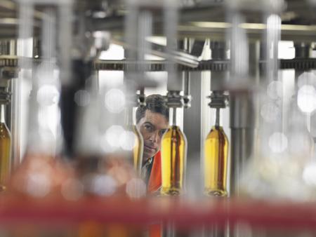 manufacturer: Factory worker in bottling plant
