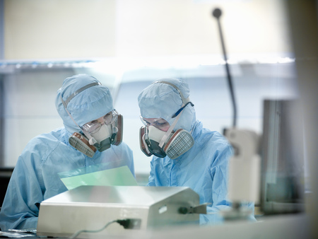 Scientists working in clean room LANG_EVOIMAGES