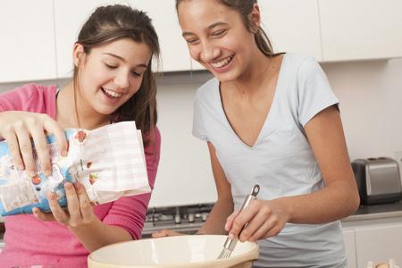 combined: teenage girls preparing food in kitchen