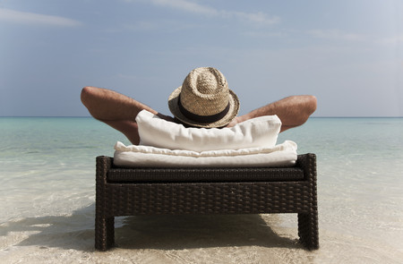 tans: Man relaxing on daybed at tropical beach