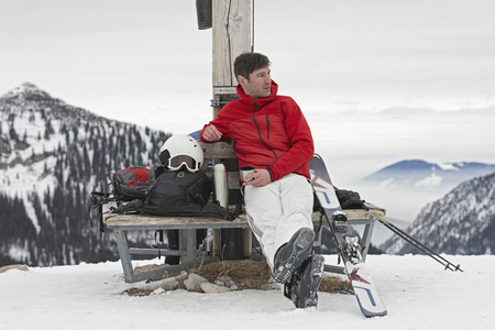 Alpinist resting on Bench
