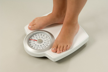 weighs: Female feet on scales LANG_EVOIMAGES