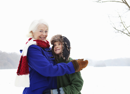 generation gap: A senior female and a boy in the snow LANG_EVOIMAGES