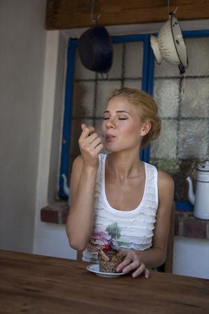 fulfill: Girl tasting cake