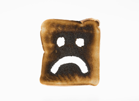 Burnt toast with sad face on it