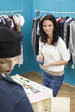 portrait of woman in clothes shop