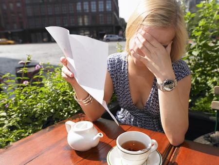 heartache: Woman reading a sad letter