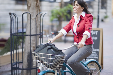 transportation: Woman riding a bicycle