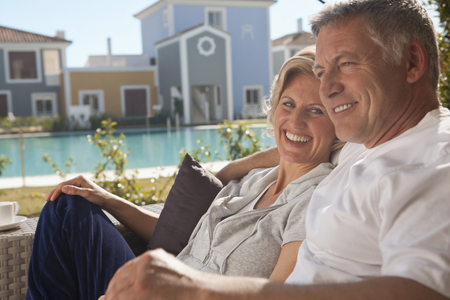 abodes: Mature couple relaxing on terrace