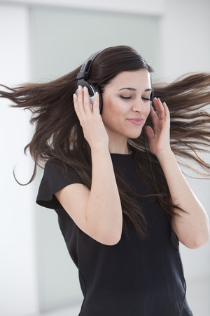 Woman dancing in headphones