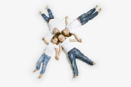 easygoing: Four toddlers laying in formation LANG_EVOIMAGES