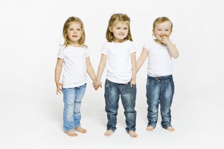 equivalents: Three toddler girls holding hands LANG_EVOIMAGES