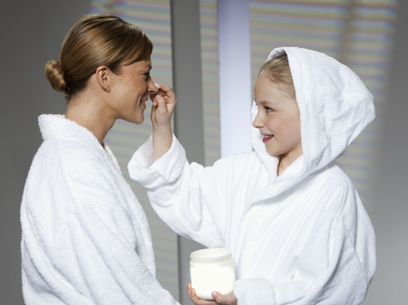 mischeif: Mother and daughter playing in bathrobes