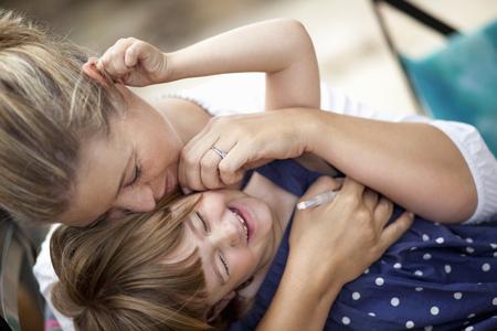 mischievious: Mom hugging kid