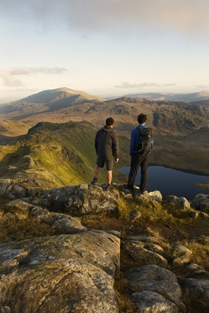 remoteness: Men admiring mountain view