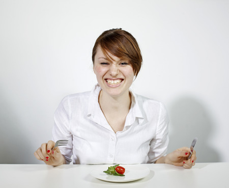 Women with Plate of Salad LANG_EVOIMAGES