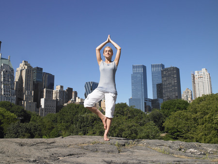 rehearse: Woman doing yoga in central park