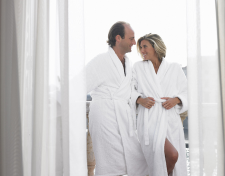 Couple in bath robe on the balcony
