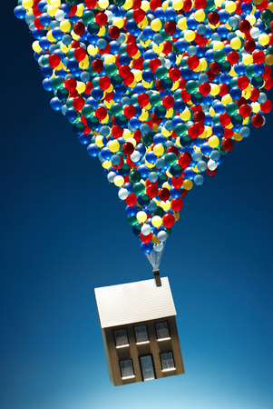 milestones: House floating with lots of balloons