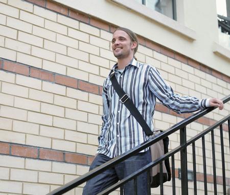 carryall: Man walking down steps outdoors