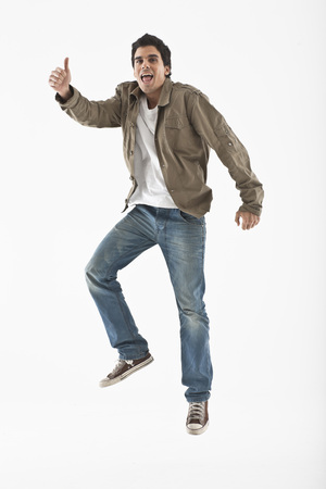 Man jumping on a white background