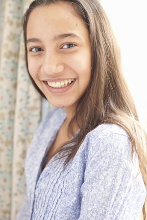 pubescent: portrait of teenage girl smiling LANG_EVOIMAGES