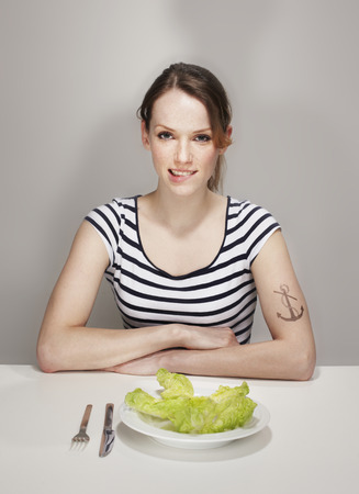 Women with Anchor Tatoo with Salad Plate