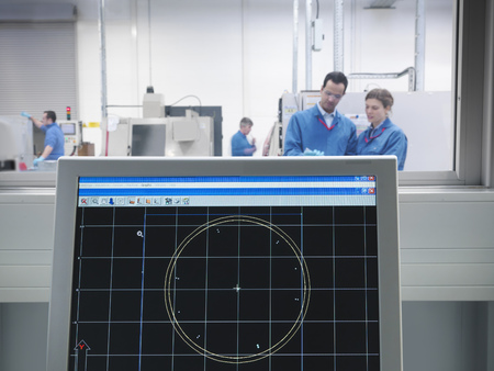 assessed: Engineers and CAD drawing on monitor