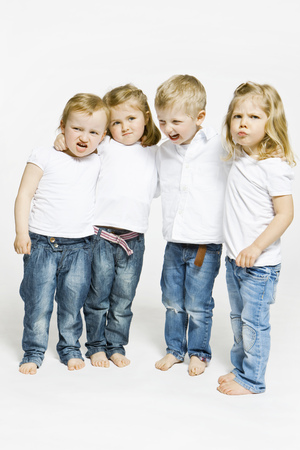 equivalents: Four toddlers hugging