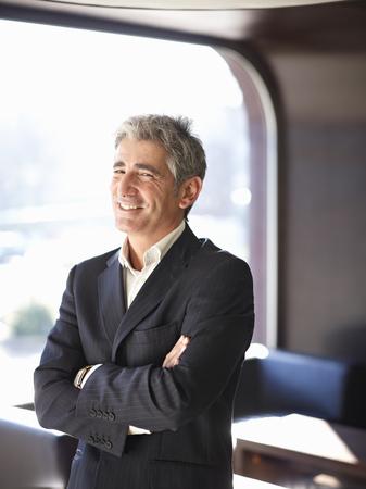 accomplishes: Portrait of Business Man LANG_EVOIMAGES