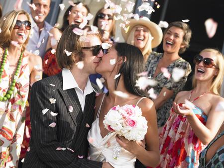 tosses: Freshly married couple kissing