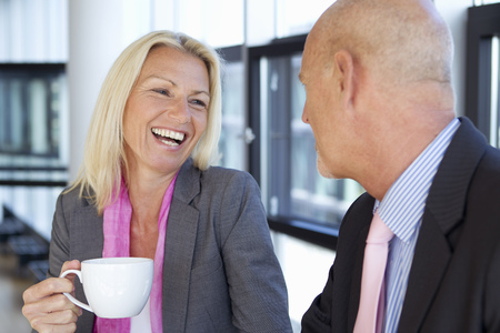 flirtation: Business people having cup of coffee