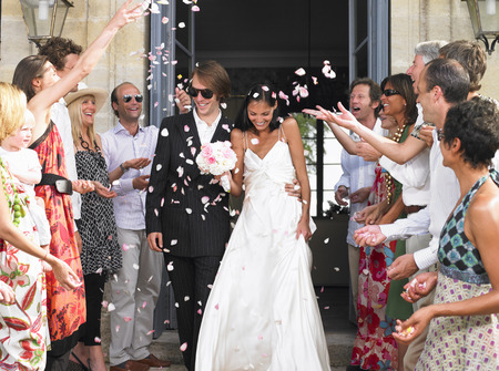 tosses: Freshly married couple leaving church