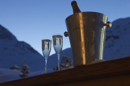 edge of the ice: Champagne glasses on snowy windowsill