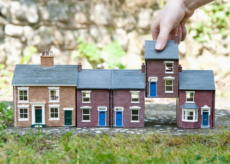 appendages: Person selecting model house