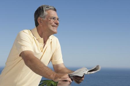 Older Man holding a newspaper