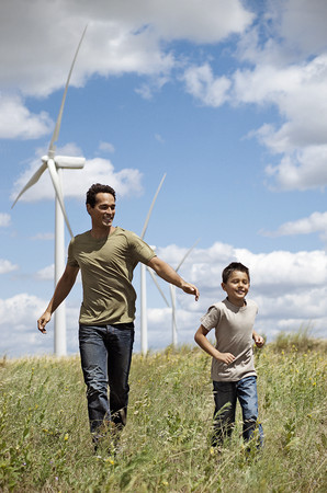 pursuing: Father and son on a wind farm LANG_EVOIMAGES