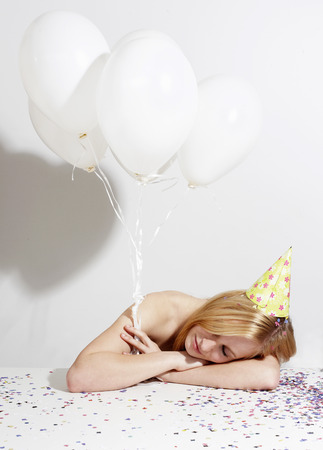 tardiness: Woman with funny hat and confetti