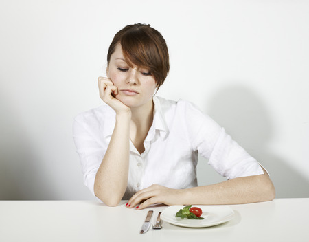 womens hands: Women with  Salad looking sad LANG_EVOIMAGES