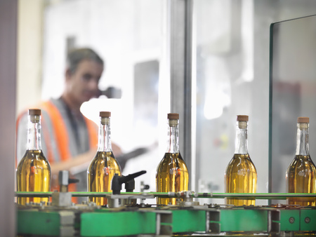 assembled: Wine bottles in bottling machine