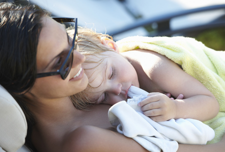 Mother and baby boy resting after pool
