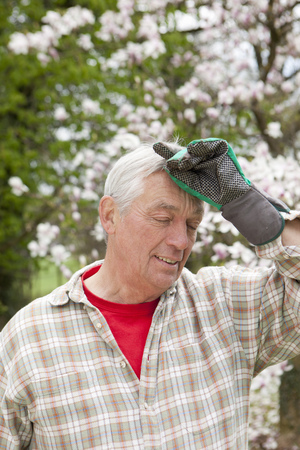 Older man wiping his brow