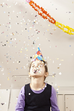 accomplishes: Little girl with confetti