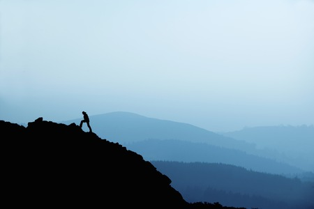 ascends: Man hiking on rocky hillside