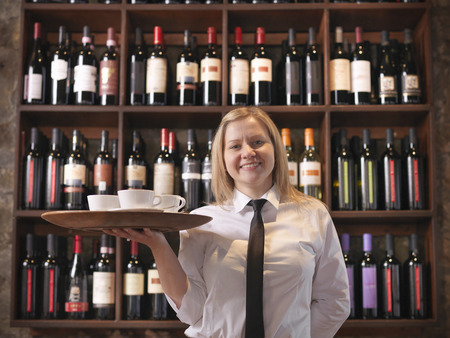 selections: Waitress holding tray of coffee