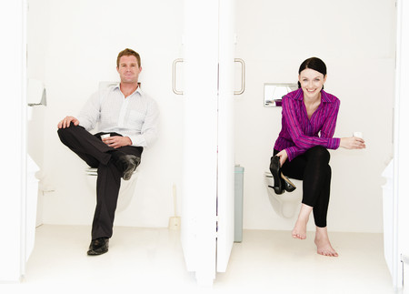 Male and female relax in toilets LANG_EVOIMAGES