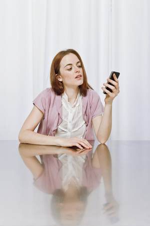 Young woman using new technology