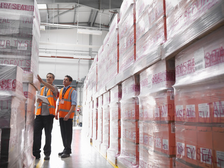 large group of business people: Workers in warehouse of bottling plant