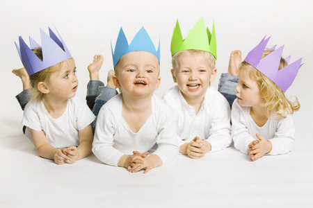 equivalents: Toddlers wearing paper crowns
