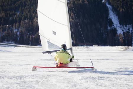 to go sledding: Ice salior sledding across frozen lake LANG_EVOIMAGES